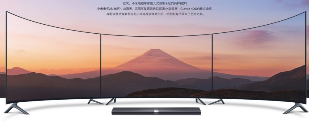 https://gyromoll.ru/images/upload/Xiaomi-Mi-TV-3S-65-INCH-4K-curved-tv-b-1024x423.jpg